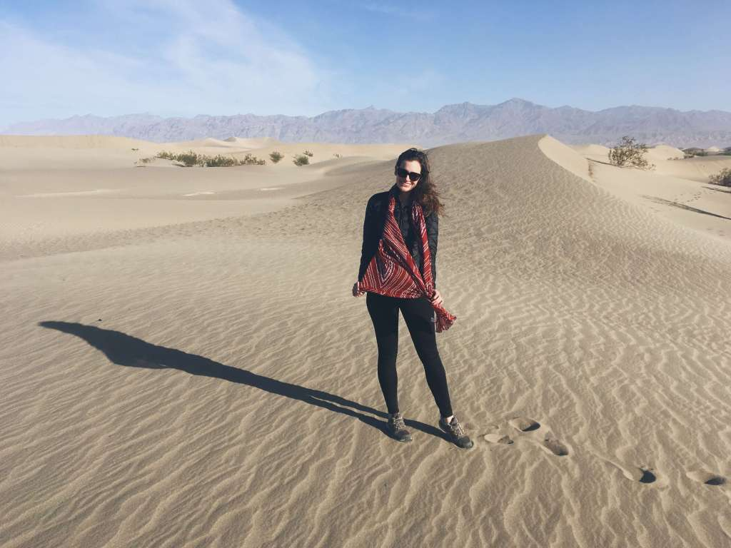Girl posing with red scarf, Mesquite Flat Sand Dunes, Death Valley National Park, California