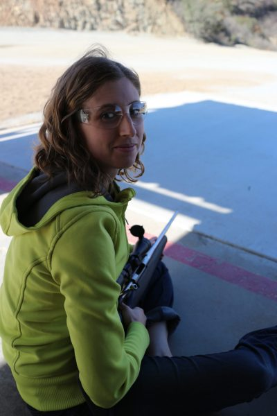 Sitting in front of the firing line at an outdoor range