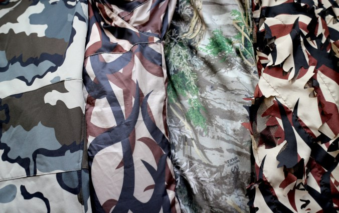 Do you need camouflage to hunt? Don't base your camo selection only on how the pattern looks up close. From left to right: KUIU Vias, ASAT, Realtree Max-1, and ASAT 3D Leafy.