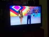 Brazilian family TV viewing featuring women in bikinis dancing erotically