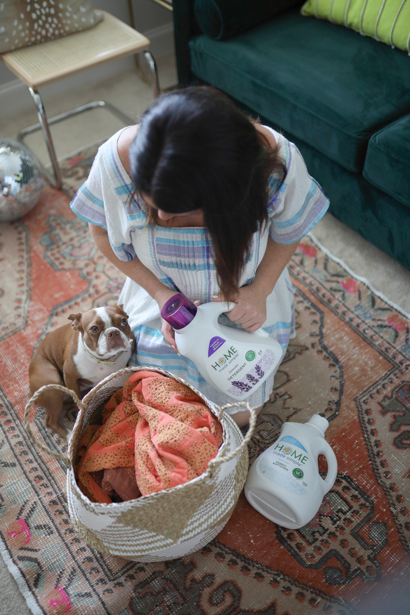 Green Cleaning Products featured by top US life and style blog Modern Day Moguls; Image of a woman cleaning her kitchen.