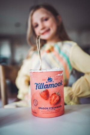 Tillamook Oregon Strawberry Ice Cream and Girl smiling down