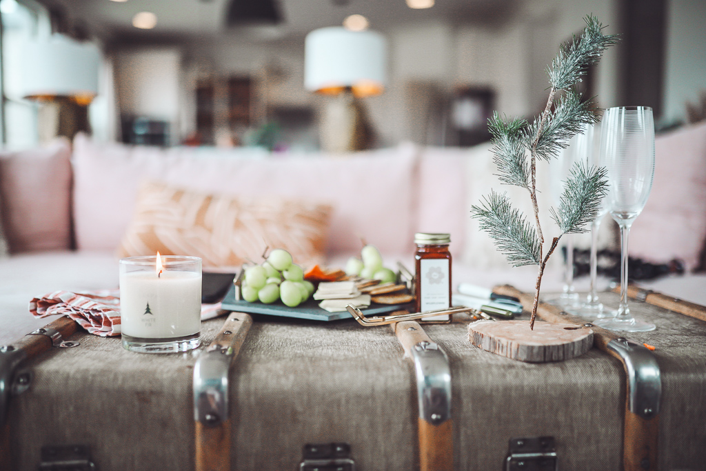 Luxury Trapp Candles Create Hygge This Holiday Season by popular Nashville lifestyle blog, Modern Day Moguls: image of holiday decor items next to a lit Trapp candle.