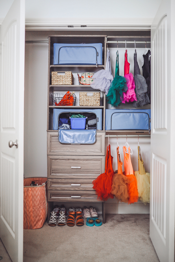 How to Organize Kids Closets Seasonally by popular lifestyle blog, Modern Day Moguls: image of a closet with Stack & Store – Collapsible 44 Liter Soft Storage Boxes inside.