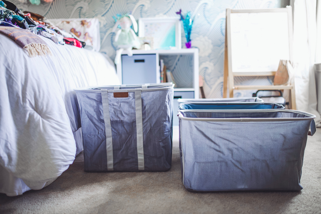 How to Organize Kids Closets Seasonally by popular lifestyle blog, Modern Day Moguls: image of a room with Clevermade Laundry Caddy - Collapsible Laundry Basket & Hamper.