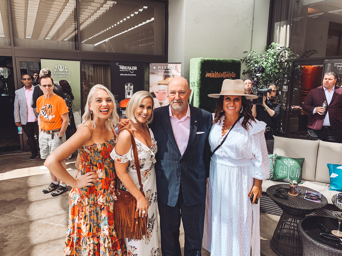 California Vacation Ideas for a Momcation in Orange County by popular Nashville travel blog, Modern Day Moguls: image of three woman standing with a man at the Westin South Coast Plaza.