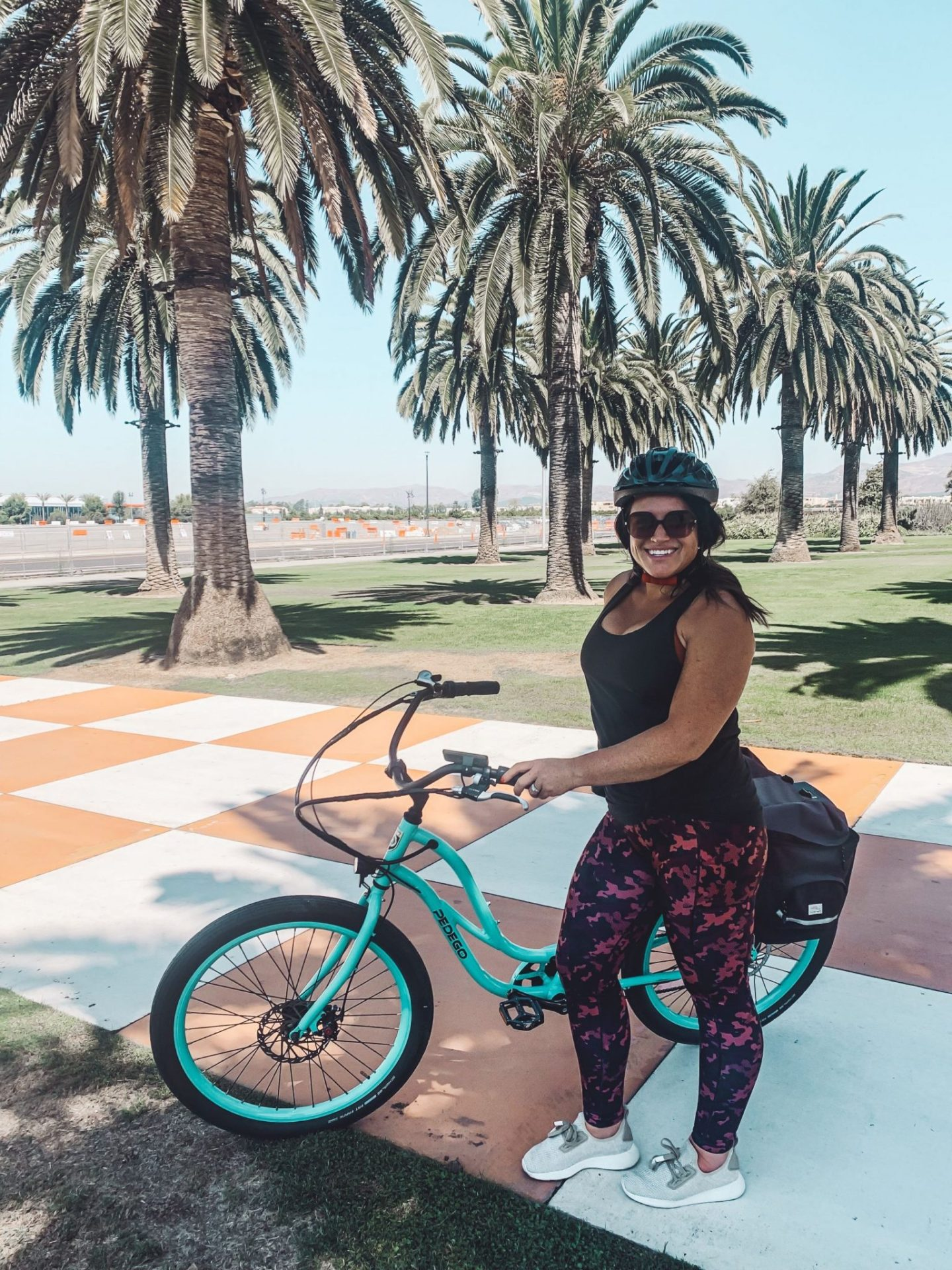 California Vacation Ideas for a Momcation in Orange County by popular Nashville travel blog, Modern Day Moguls: image of a woman on a bike.