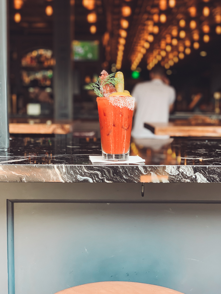 California Vacation Ideas for a Momcation in Orange County by popular Nashville travel blog, Modern Day Moguls: image of a bloody mary drink.