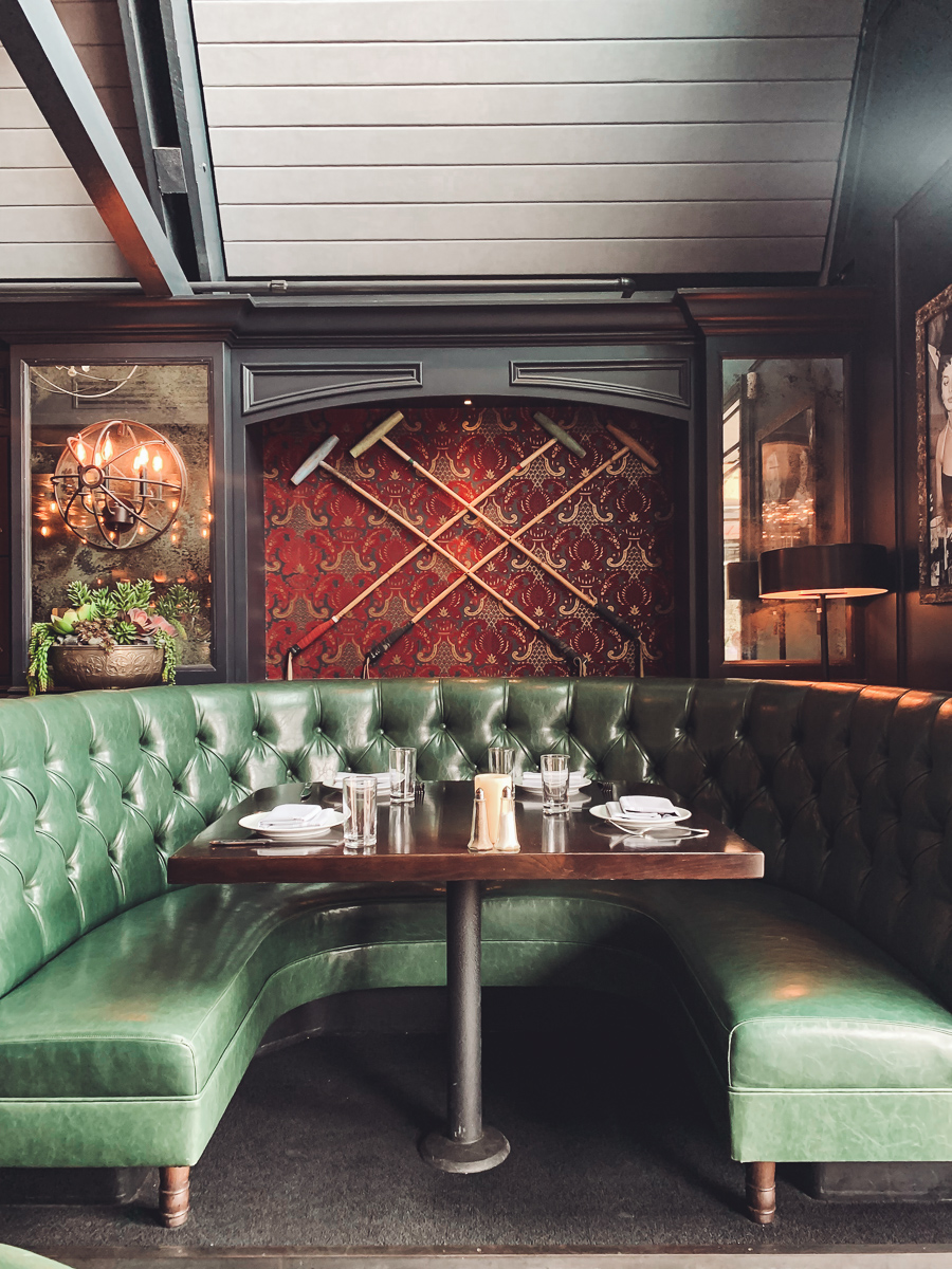 California Vacation Ideas for a Momcation in Orange County by popular Nashville travel blog, Modern Day Moguls: image of a restaurant booth.