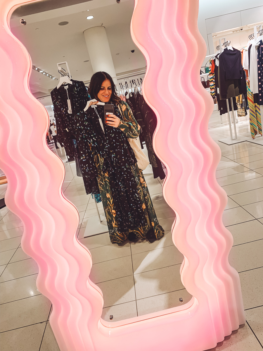 California Vacation Ideas for a Momcation in Orange County by popular Nashville travel blog, Modern Day Moguls: image of a woman standing in front of a dressing room mirror.