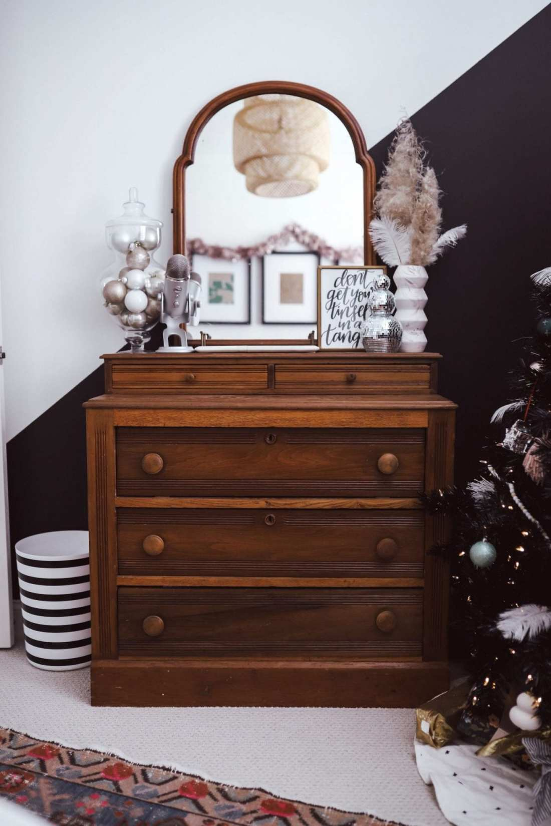 5 Ways to Decorate with Feathers for Boho Christmas Decor by popular Nashville lifestyle blog, Modern Day Moguls: image of a dresser decorated with Oriental Trading Feathers, Wooden Beads, Matte Ornaments, Apothecary Jar with Lid.