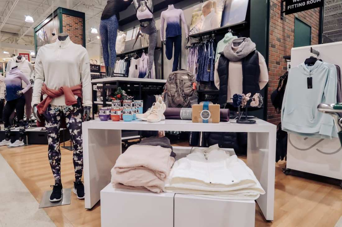 Unwrap the Magic of Sports with Dick's Gift Ideas by popular Nashville life and style blog, Modern Day Moguls: image of DSG Holiday Capsule Collection, CALIA by Carry Underwood, and Metcons.