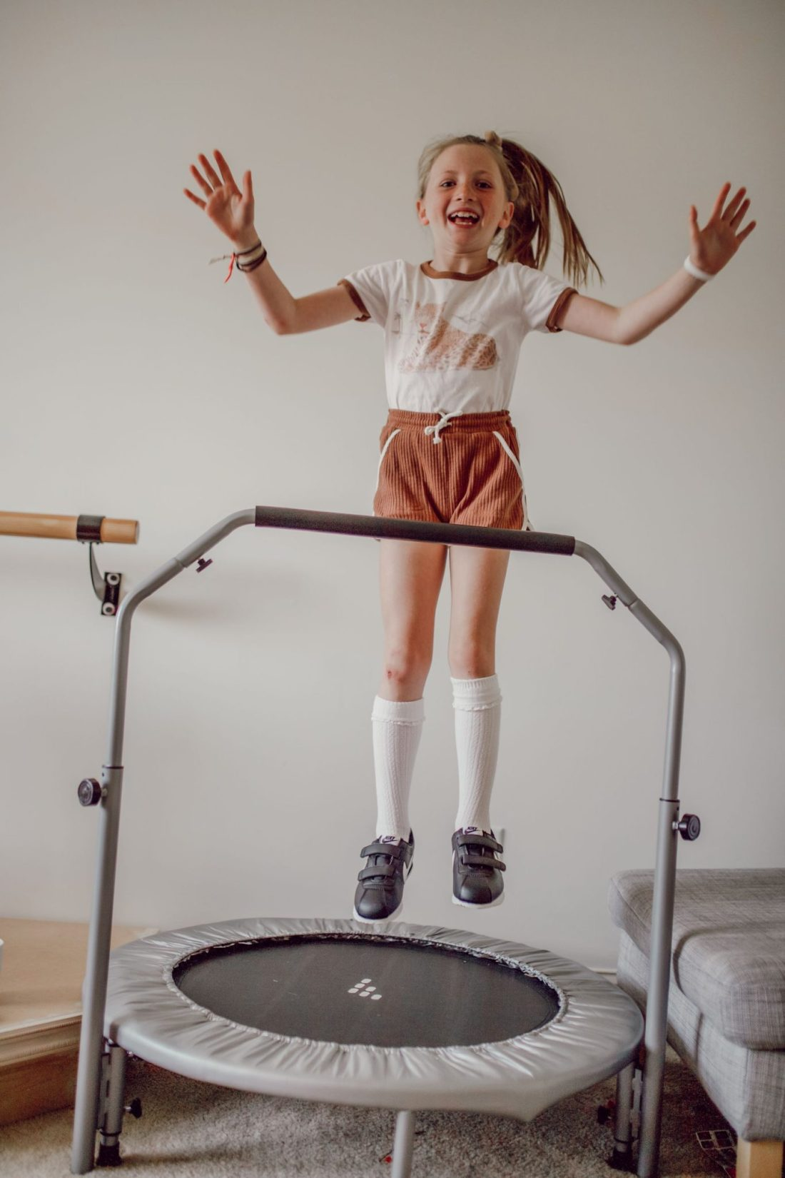 Homeschooling Journey by popular Nashville lifestyle blog, Modern Day Moguls: image of a little girl jumping on a exercise trampoline.