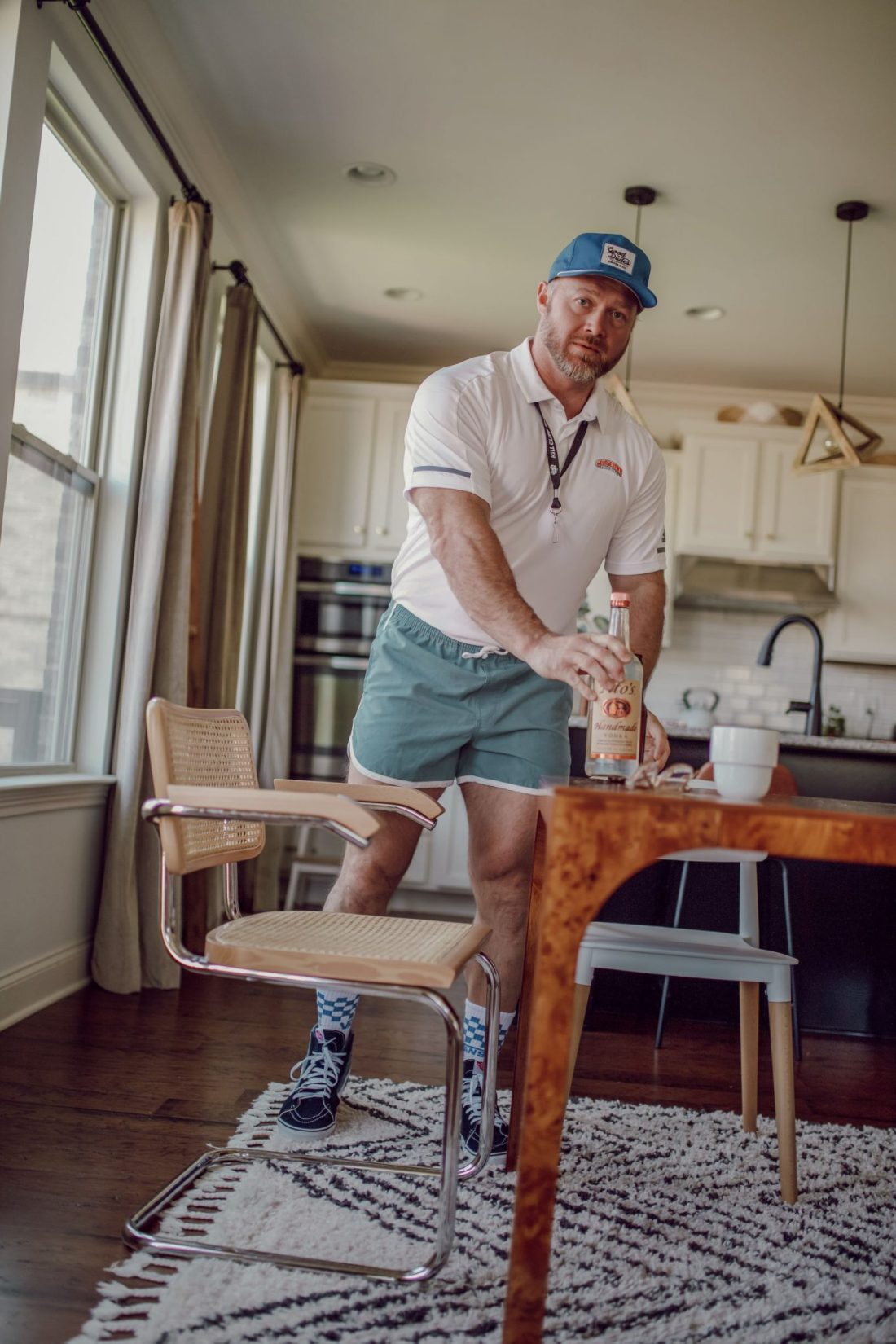Homeschooling Journey by popular Nashville lifestyle blog, Modern Day Moguls: image of a man dressed up as a gym teacher and placing bottle of liquor on the table.