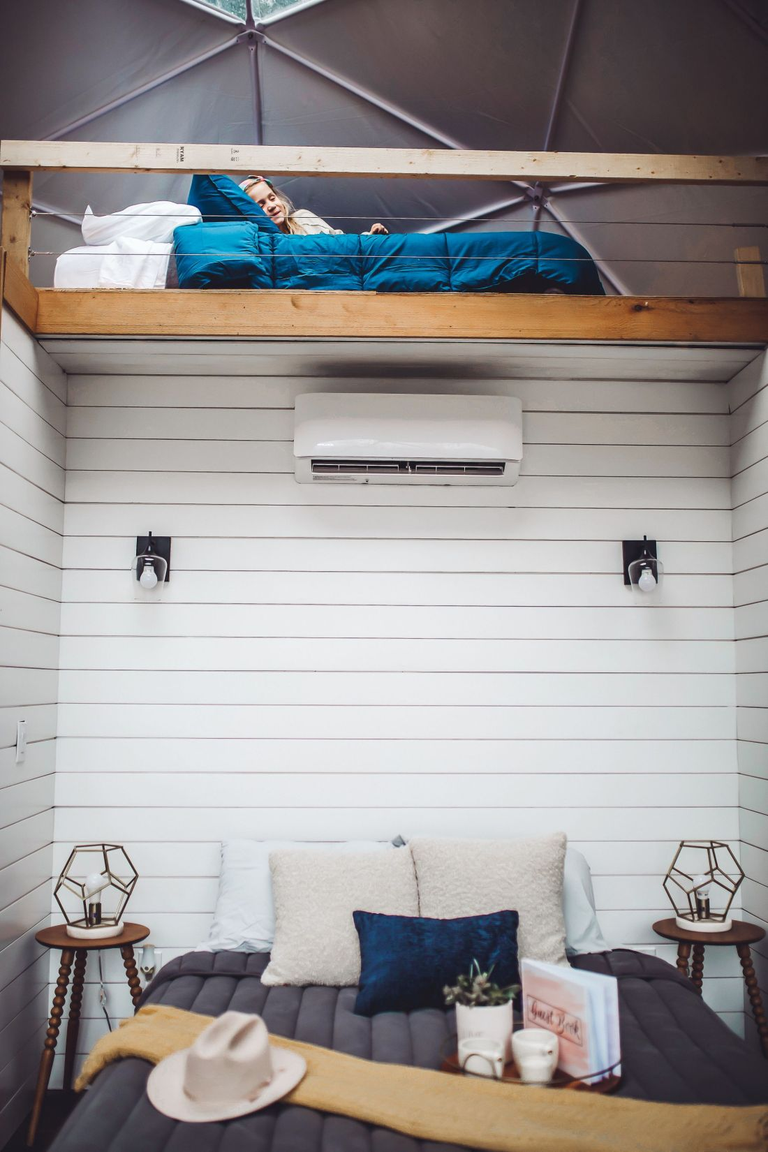 Glamping in Tennessee by popular Nashville lifestyle blog, Modern Day Moguls: image of bed and a loft in a geodesic dome.