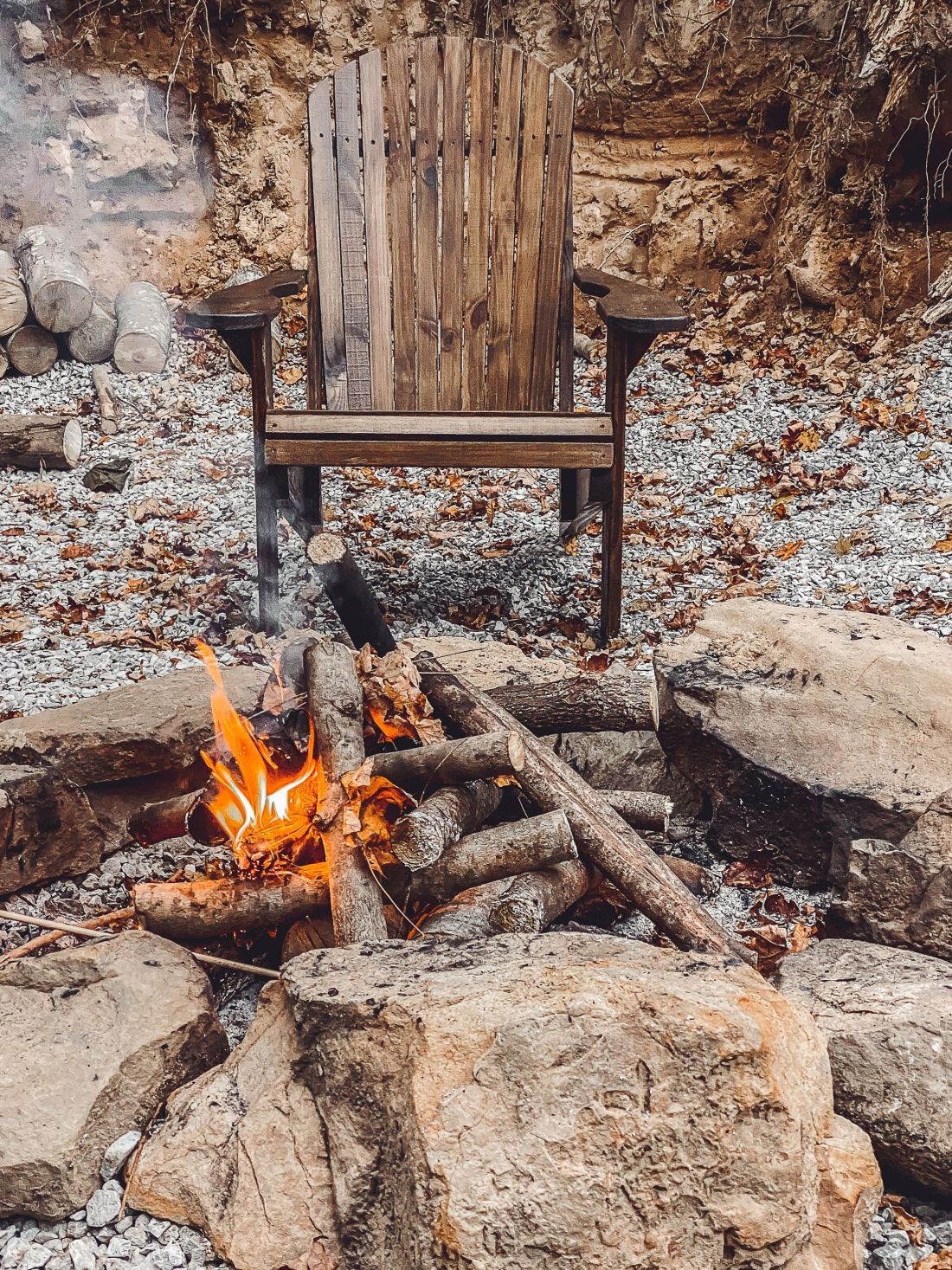 Glamping in Tennessee by popular Nashville lifestyle blog, Modern Day Moguls: image of a chair in front of a fire pit.