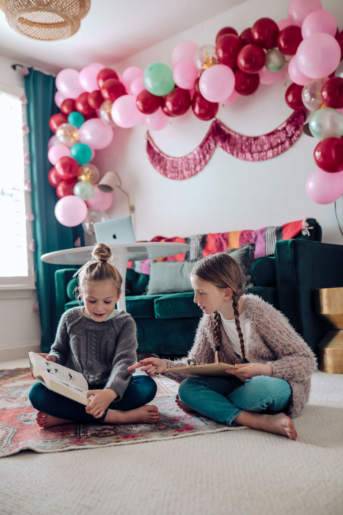 Carpet and Rug Institute by popular Nashville life and style blog, Modern Day Moguls: image of two girls in on a Carpet and Rug Institute rug in a home office decorated with a balloon garland, and fringe tinsel garland.