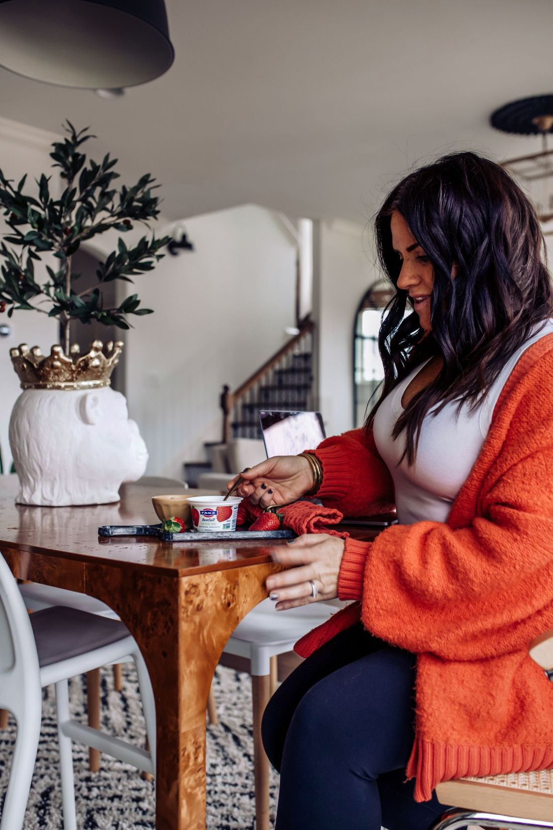 Keeping New Year's Resolutions by popular Nashville lifestyle blog, Modern Day Moguls: image of a woman eating some Fage yogurt.