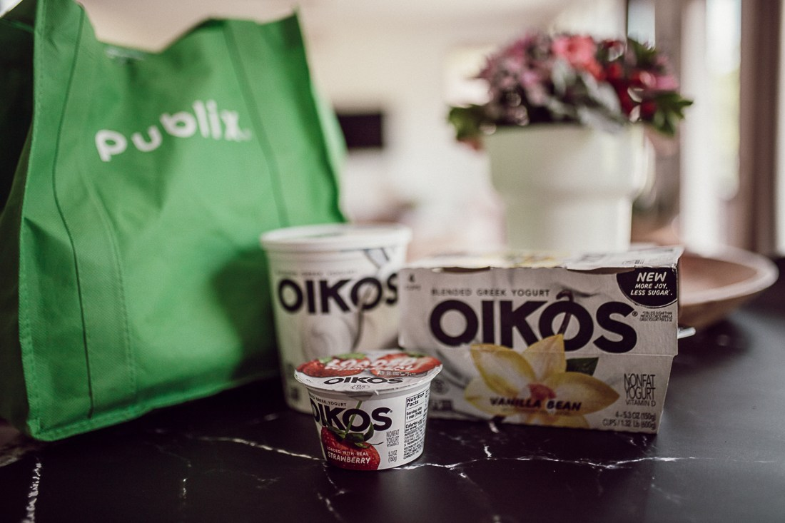 Oikos Greek Yogurt by popular Nashville lifestyle blog, Modern Day Moguls: image of Oikos Greek yogurt products by a reusable Publix shopping bag.