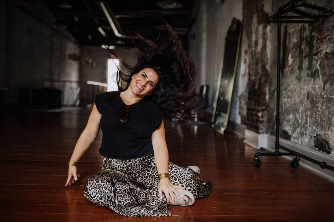 Hair Cut by popular Nashville beauty blog, Modern Day Moguls: image of a woman sitting n the floor and slipping her hair.
