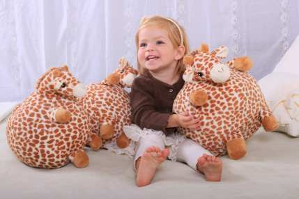13. CloudB - Gentle Giraffe Poufs