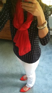 Navy patterned top, white jeans, red accents