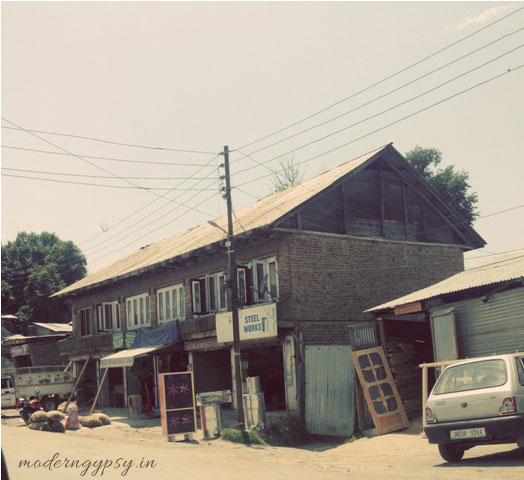A typical Kashmiri house with sloping roofs