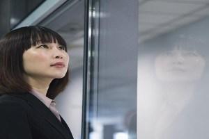 Businesswoman looking through glass, reflection, Beijing