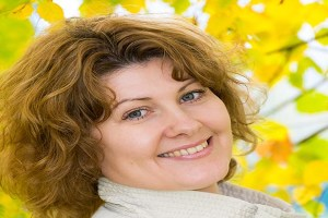 A Middle-aged woman in the autumn park ** Note: Shallow depth of field