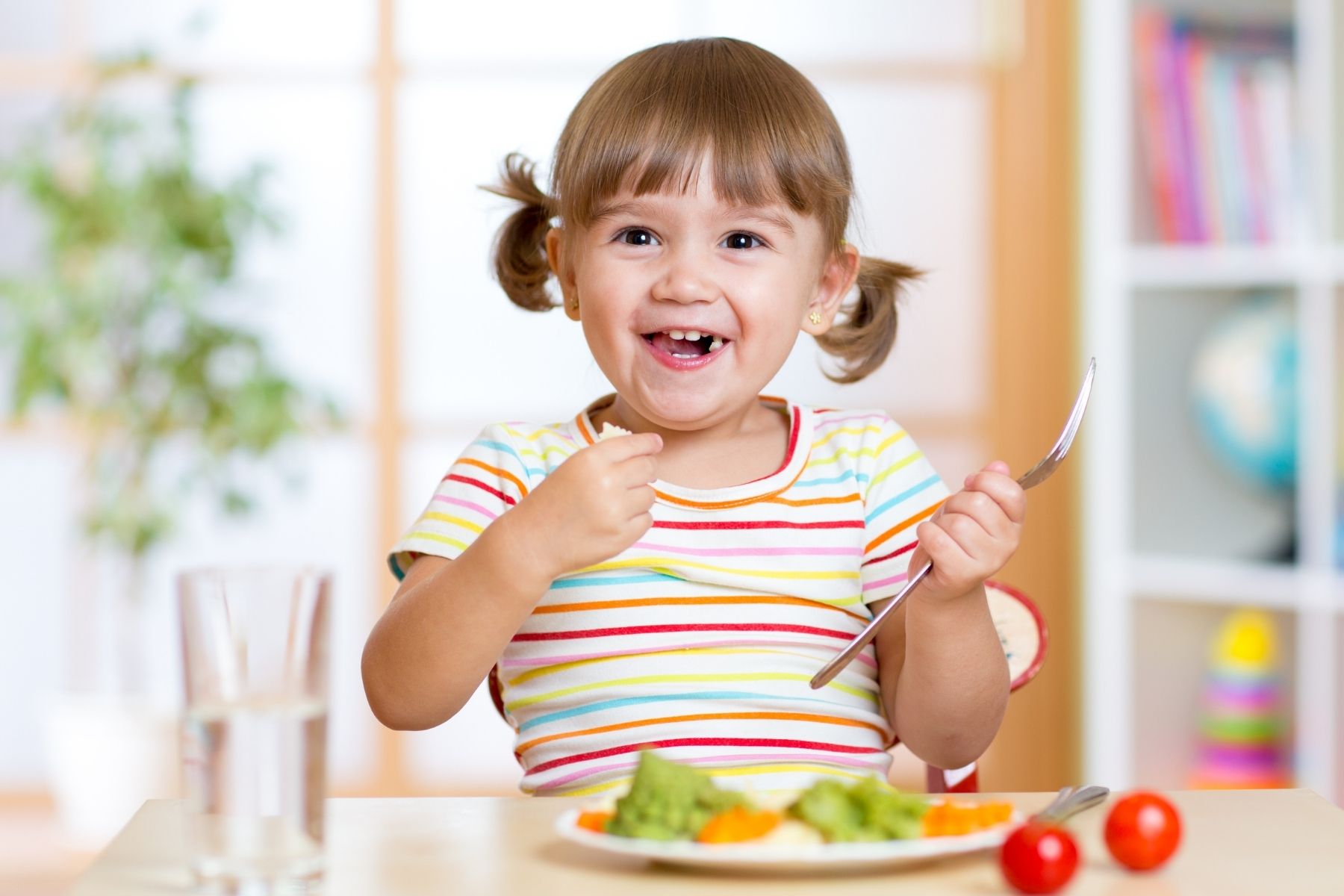 Happy Toddler Eating Meal