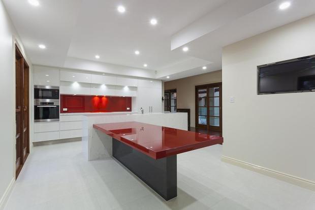 high gloss white w feature red quartz