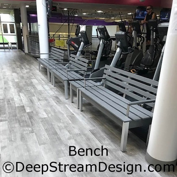 An example of DeepStream Custom Fixtures showing several benches in a hotel gym made with recycled plastic lumber