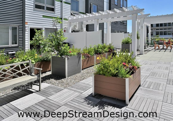 Recycled Plastic Lumber wood planters add a tranquil green space on a roof deck between apartments blocks