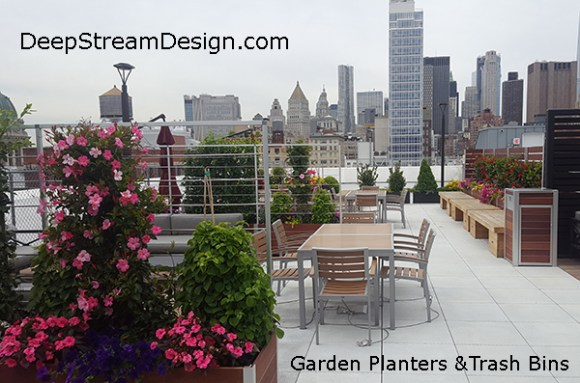 Example of Wood garden planters with privacy screen on an urban rooftop patio