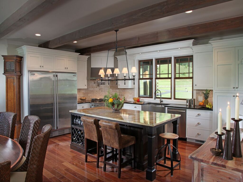 espresso-hued wood on island and quartz countertops