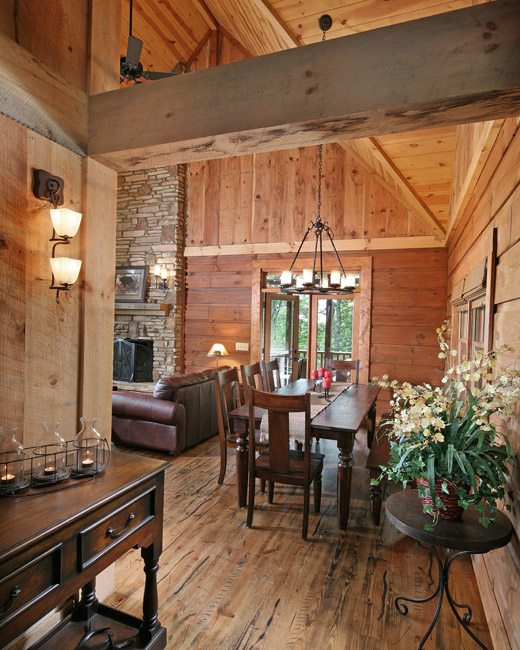 Rough-sawn beams and planks are coupled with the ceiling's smooth white pine tongue-and-groove