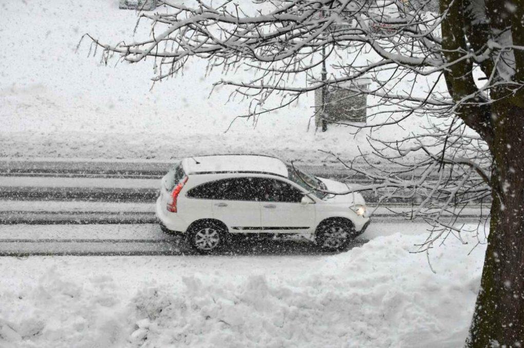 car in snowstorm