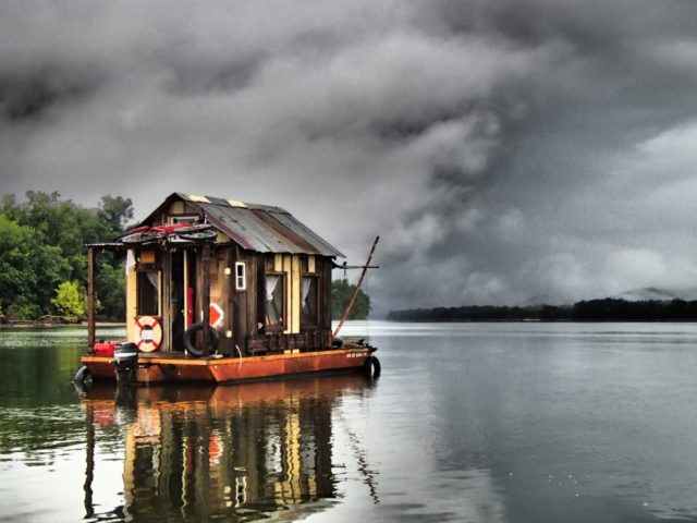 Storm looms over the Shantyboat Dotty on the Tennessee River