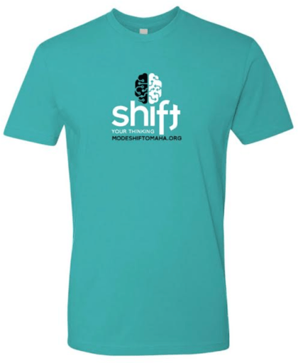 """A teal crew neck t-shirt with a black and white brain with the word """"Shift"""" in white below it. Under that also in white it says """"your thinking"""" with ModeShiftOmaha.org in black at the bottom."""