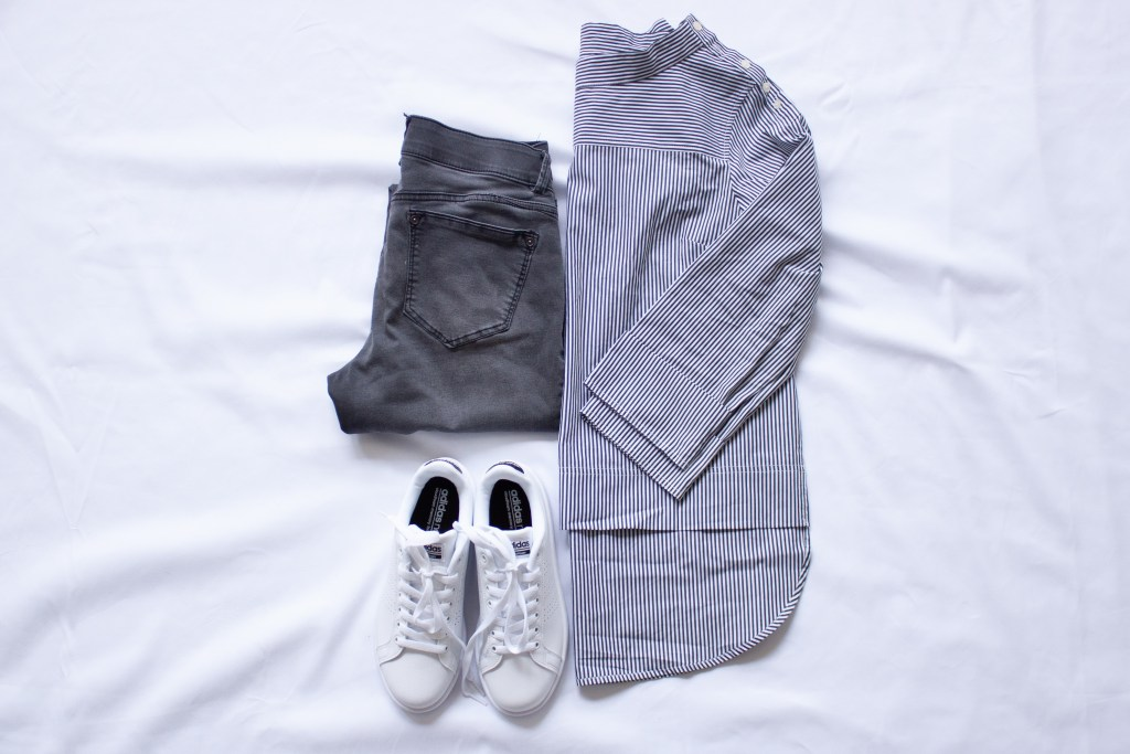 striped funnel neck top, gray jeans, white sneakers