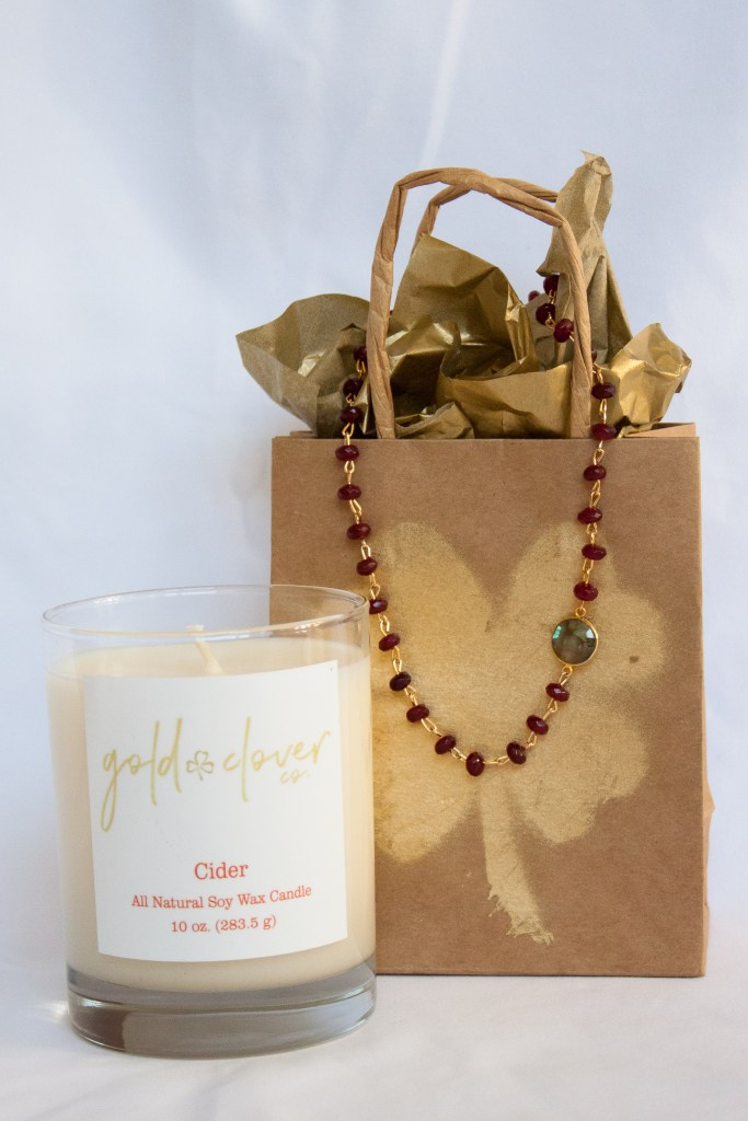 after thanksgiving shopping gold clover candle and necklace
