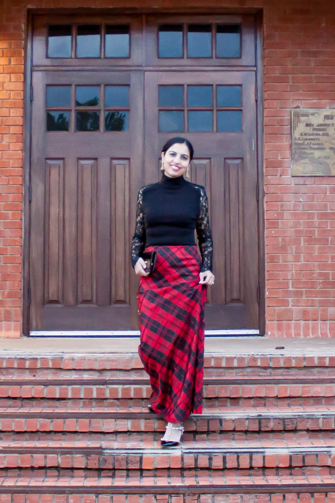 modest holiday party look tartan skirt and turtleneck