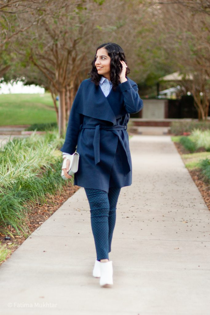 navy belted sweater, dot pants, and white boots