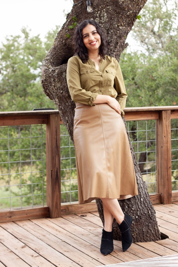 fall neutral outfit olive button down top, camel midi skirt black booties