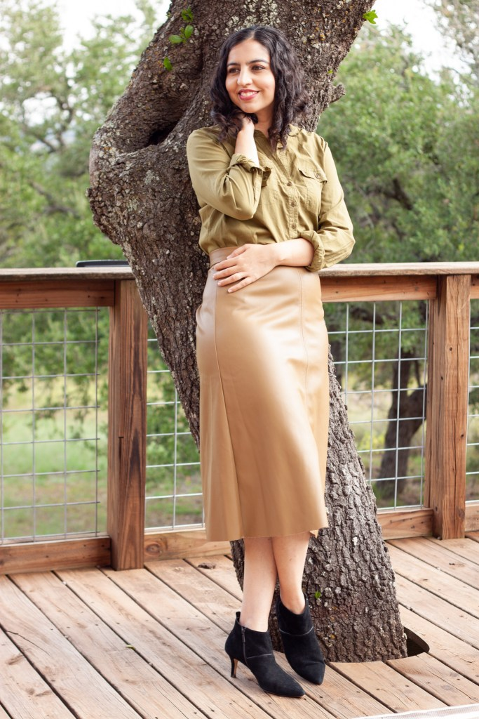 fall fashion idea olive green top and brown faux leather midi skirt