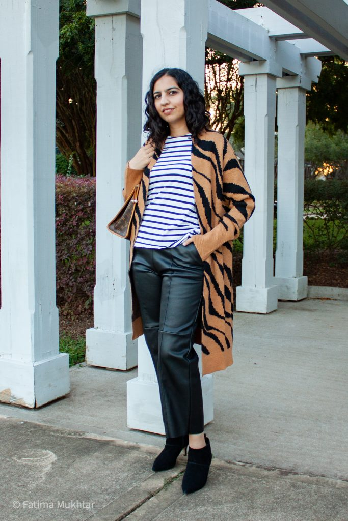 long cardigan outfit ideas zebra print sweater and black leather pants