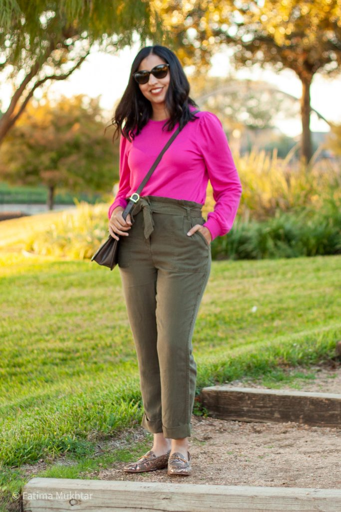 modest work outfit idea hot pink sweater paper bag pants