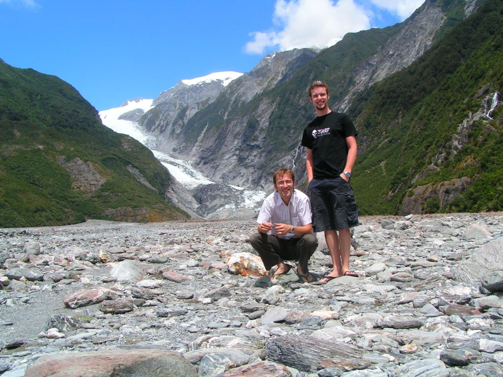 Two brothers stand in the creekbed below Franz Josef Glacier on New Zealand's West Coast. The Glacier forms part of Westland Tai Poutini National Park, and is receding rapidly due to climate change and global warming.