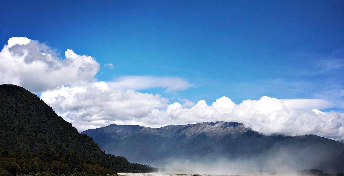 A view of the mountains and river near Haast, a UNESCO World Heritage site.
