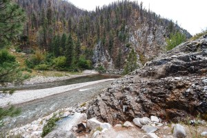 Idaho Hot Springs - The Best Natural Hot Tub Waterfall - Pine Flats Campground and Hot Spring. A view of the upper thermal pools that create a waterfall over the South Fork of the Payette River.